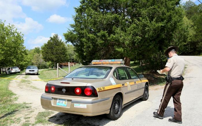A Jefferson County Sheriff deputy is at a police scene in Desoto, Mo., in Jefferson County in Septem