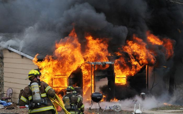 Firefighters battling a blaze from a shake-and-bake meth lab explosion Jan. 29, 2010, at a house in