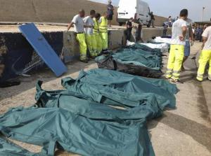 Body bags containing African migrants, who drowned trying to reach Italian shores, lie in the Lamped