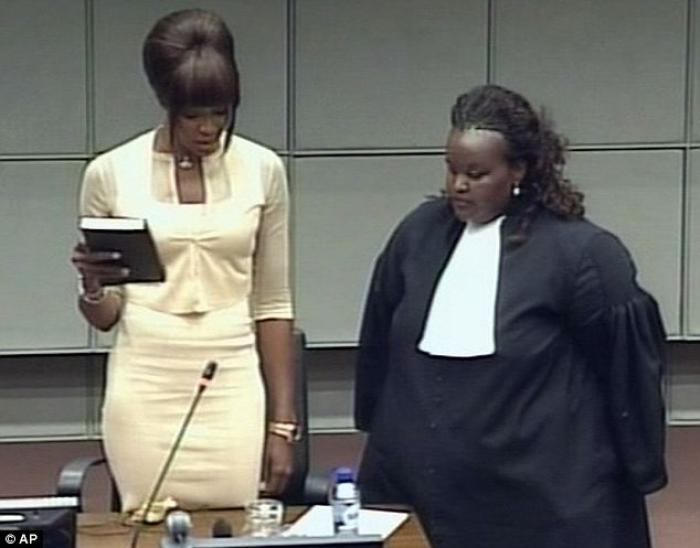 Naomi Campbell is seen holding the bible being sworn in at the Special Court for Sierra Leone, where