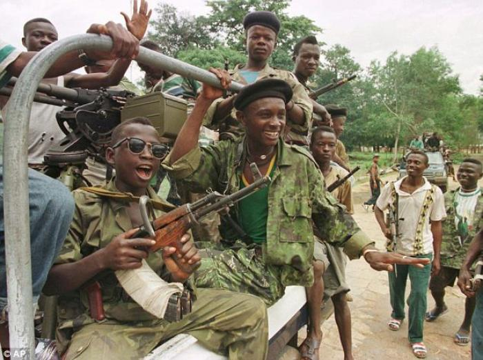 In this June 10, 1997 file photo, soldiers from the Revolutionary United Front supported by Taylor r