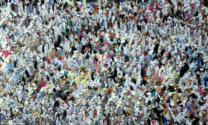 Muslim worshippers wait before performing the afternoon prayer at the mosque in Saudi Arabia.