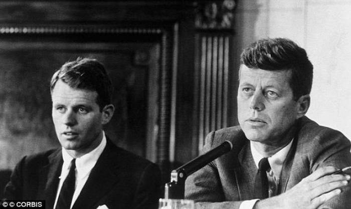 A new book alleges that Robert Kennedy (left) took the case that contained his brother Jack