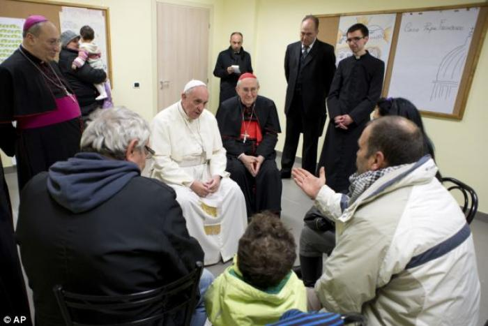 Pope Francis spoke to people about his youth and vocation when he visited a working-class neighborho