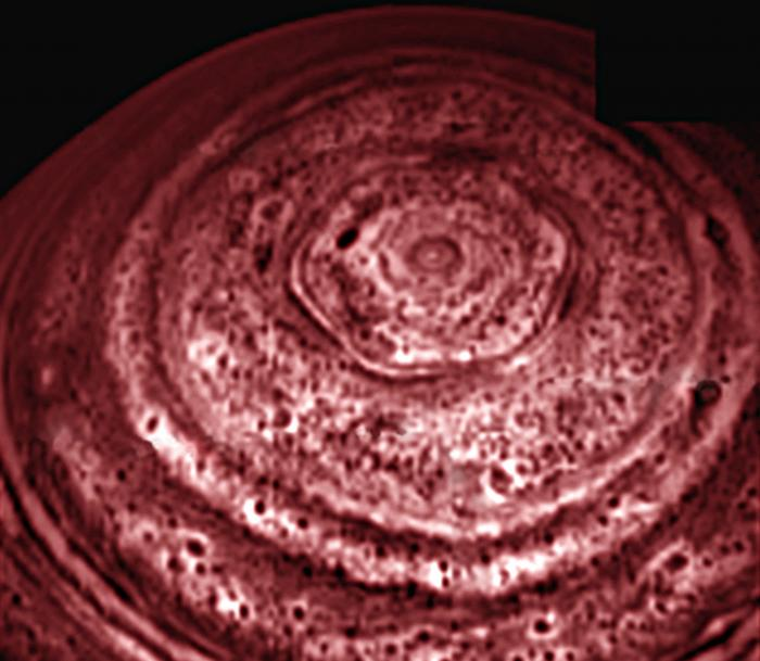Another false color image of the hexagon. The center is home to a vicious vortex.