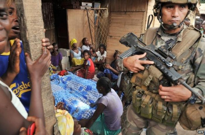 French peacekeepers continue to patrol Bangui as families mourn new victims of the inter-religious v