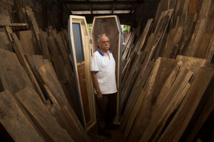 The casket business is booming as funerals happen daily. Image: Ed Kashi