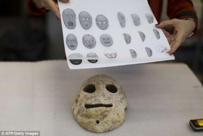 The people who carved the masks (pictured) were among the first humans to abandon nomadic life and s