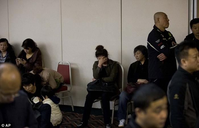 Relatives of Chinese passengers aboard the missing Malaysia Airlines, MH370 gather at a hotel ballro