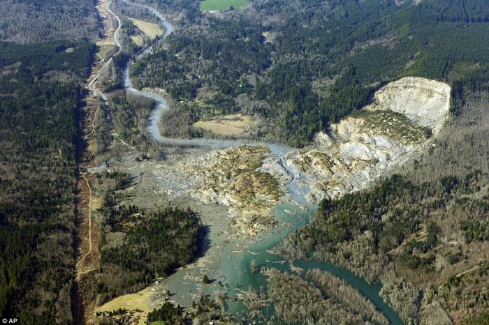 The massive mudslide that killed at least 14 people on Saturday and left 176 missing is shown in thi