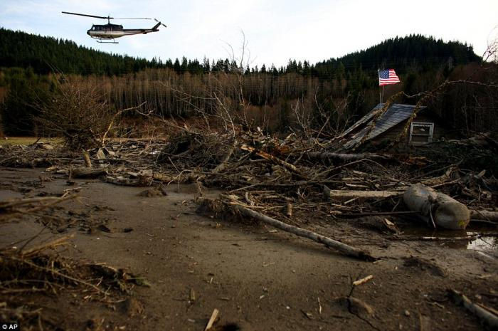 From a helicopter, Snohomish County Sheriff Ty Trenary surveys the wreckage of homes destroyed in Sa