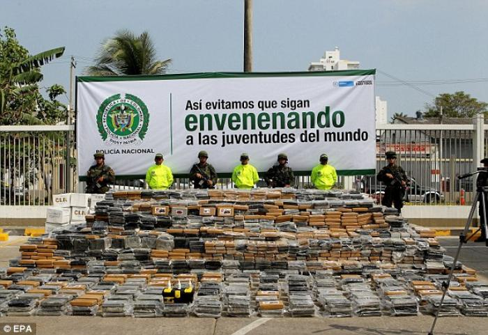 Members of the Colombian National Police present to the media the 7 tons of cocaine confiscated in a