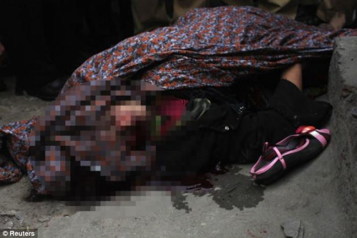 The body of Farzana Parveen lies in the street.