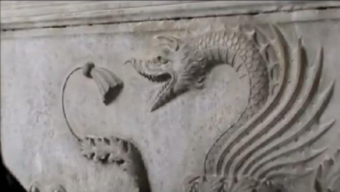The tomb is covered in carvings including a dragon (pictured) which the expert says means Dracula, w