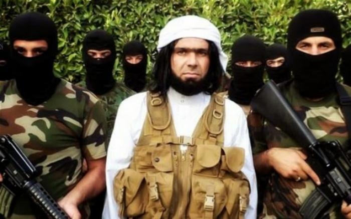 Shakir Wahiyib, center, is unusual in the ISIS army that he will appear on camera without covering h