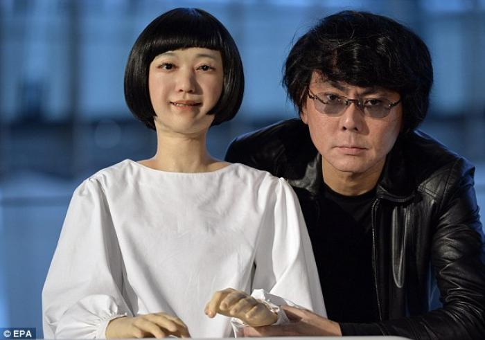 Japanese robotic scientist Hiroshi Ishiguro (right) poses next to girl android robot named Kodomoroi