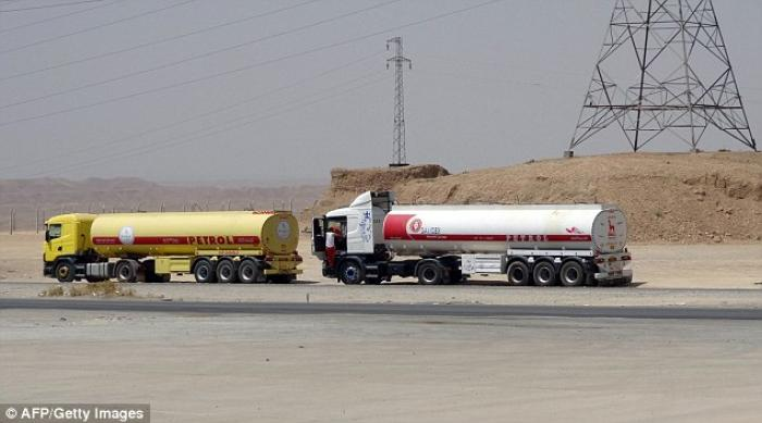 Oil tankers, owned by the Islamic State, transport petrol to to be sold to Kurdish businessmen.