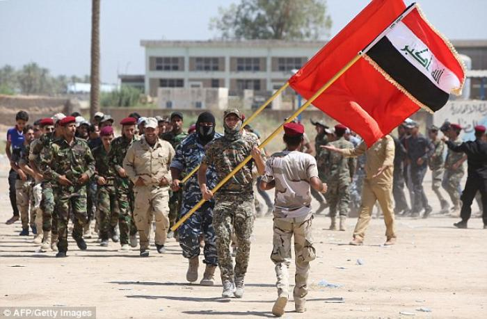 Human Rights Watch has said Iraqi security forces, such as those pictured, killed prisoners when the