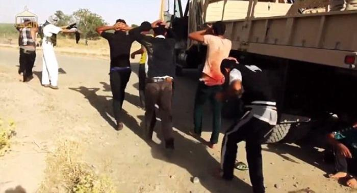 Off the trucks, men and boys are forced to march to their place of execution where a ditch has been