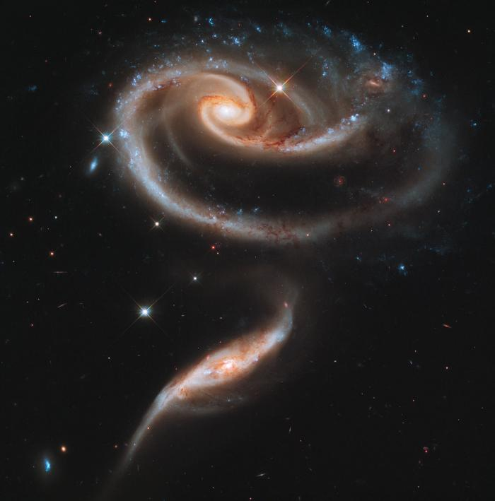 A pair of galaxies known as Arp 273. Observations show the smaller galaxy has collided and passed th