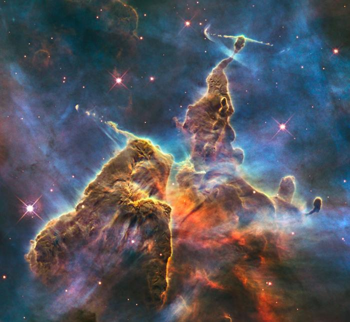The Carina Nebula is a vast complex of dust and gas which forms new stars and almost certainly their