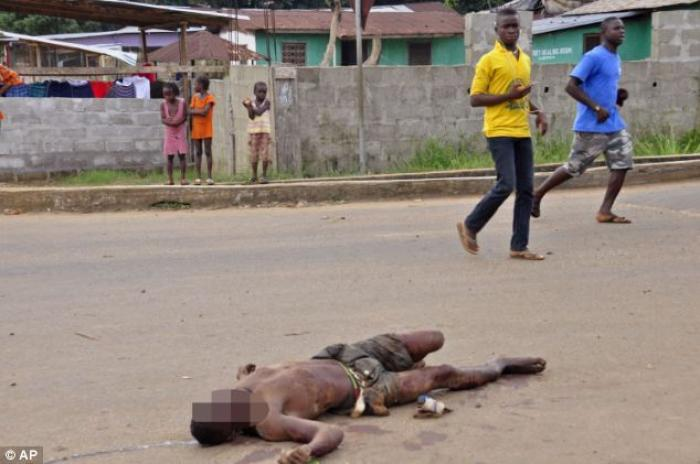 The body of a man who has been infected with the Ebola virus lies dead in the streets of Liberia.