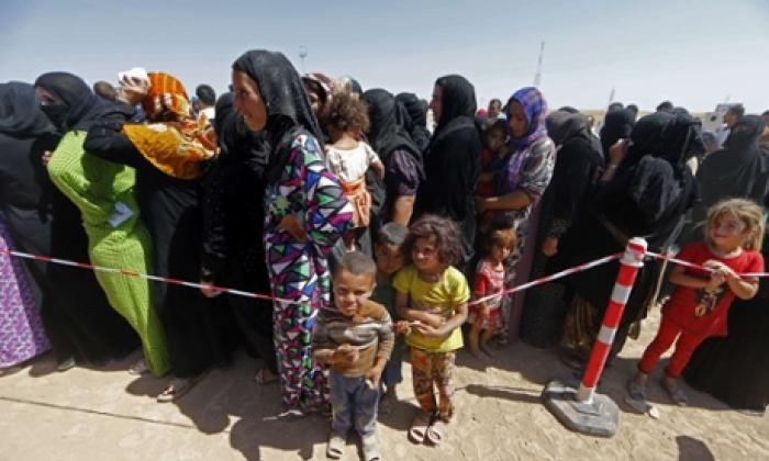 Refugees flood into ill-prepared safe havens as ISIS terrorists drive them from their ancestral home