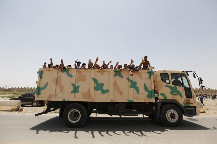 All of the men in the back of this truck are now dead, among the thousands of Iraqi soldiers execute