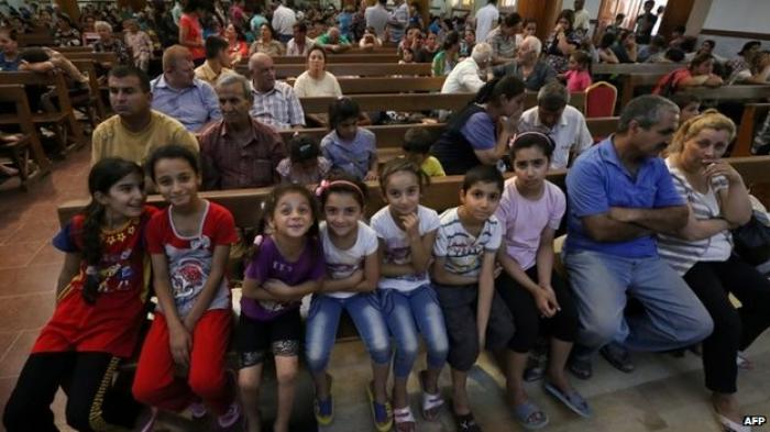 Many of the Iraqi Christians who fled the violence have arrived in the Kurdish city of Erbil.