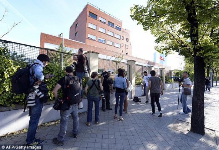 Journalists gathered outside the hospital in Spain
