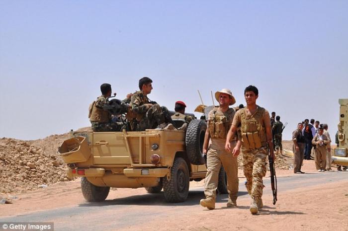 Kurdish peshmergas patrol in Mahmur.