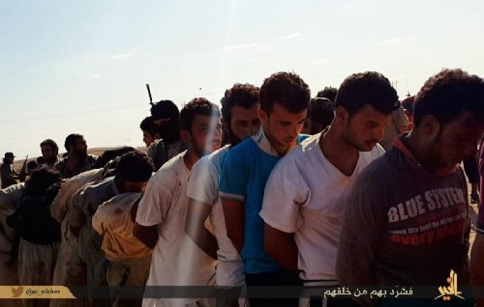 Captured Sunni tribesmen, accused of disloyalty are marched, barefoot in 120 degree heat, to their d