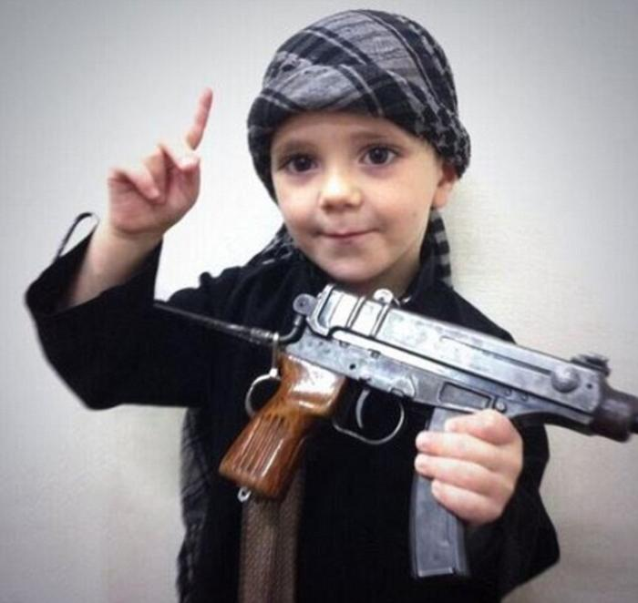 A child is poses with a weapon for ISIS propaganda. These people have no scruples, no inhibitions. F