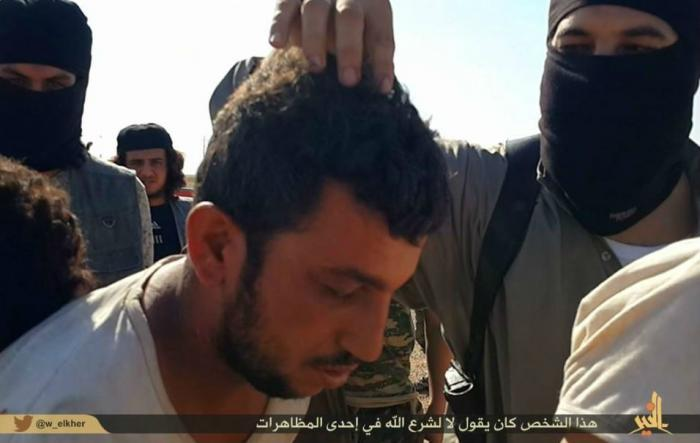 A man has his hair pulled, a form of insult in Islamic culture. He is about to die.