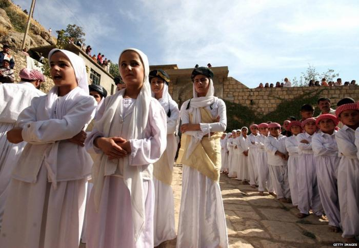 Girls and boys from a Yazidi religious school sing hymns and prayers at Lalesh temple.