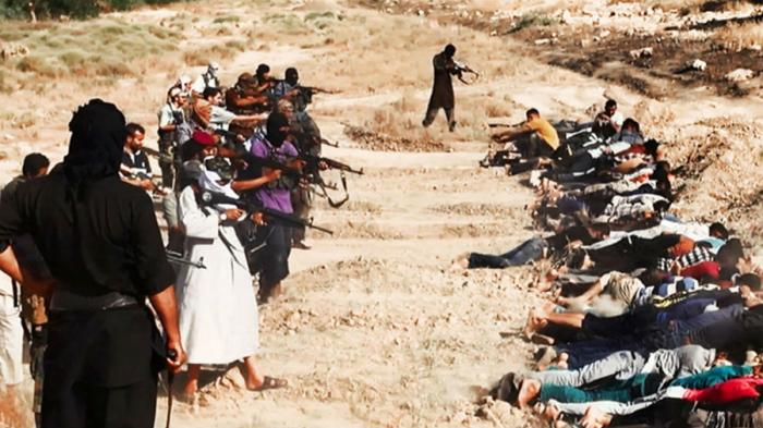Militants from the Islamic State execute a group of Iraqis.