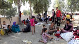 Displaced people from the minority Yazidi sect, fleeing the violence in the Iraqi town of Sinjar wes