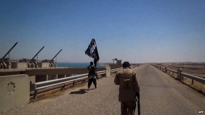 The black flags of jihadist group Islamic State flew over the Mosul dam for 10 days before it was re