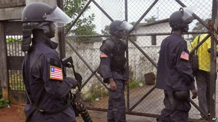 Liberian security forces protect a medical center. Security forces have been deployed following the