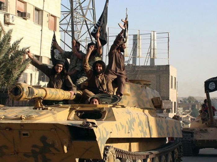 Fighters from the Islamic State ride a tank in Iraq. The group is one of the most well funded and su