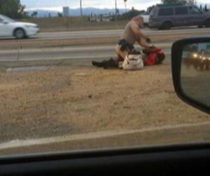 This grainy picture is taken from a video showing a California Highway Patrol officer beat a woman o