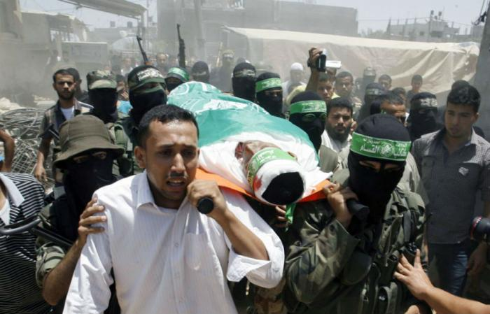 Reports say that tens of thousands of Palestinians attended the funerals of the dead Hamas commander