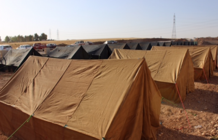 Church grounds in Irbil are dotted with makeshift tents in 105-degree heat.