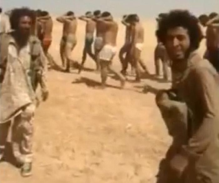 Islamic State guards leer at the camera as they death march 250 men to their deaths.