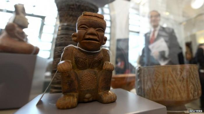 14th century artifacts from Colombia being displayed in a Spanish museum.