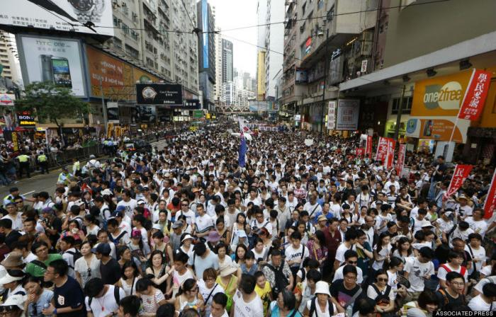 A group of protesters marching against Chinese interference in Hong Kong.