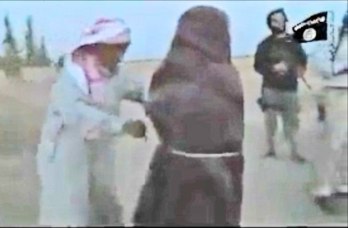 As the militants rain down rocks on the defenseless woman, her father (left) steps forward and picks