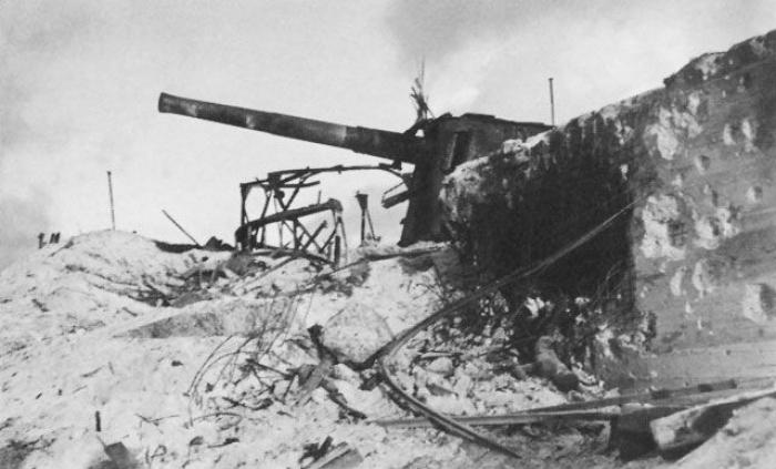 A destroyed Japanese defensive position and coastal gun.