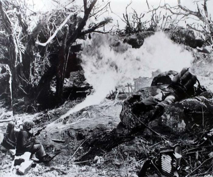 Marines with flamethrowers destroy Japanese positions.