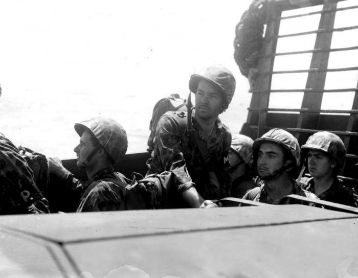Marines aboard a landing vehicle which will take them ashore.